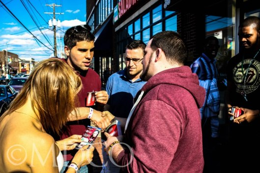 Carl speaking to people during a street ministry.