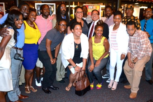 The panelist and Councilman Oh pose for a picture with the young entrepreneurs responsible for the event.